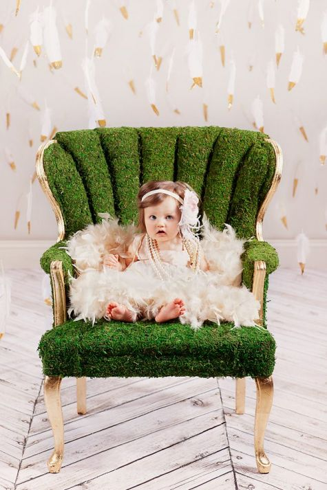 Bo-ho baby in moss-covered chair