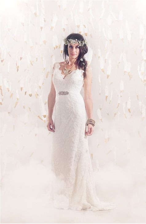 Ethereal bride in gold-dipped feathers